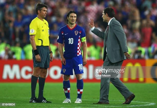 Slaven Bilic coach of Croatia talks to referee Roberto Rosetti during the penalty shoot out in the UEFA EURO 2008 Quarter Final match between Croatia...