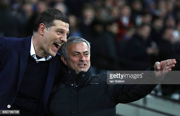 Slaven Bilic Manager of West Ham United and Jose Mourinho Manager of Manchester United speak propr to the Premier League match between West Ham...