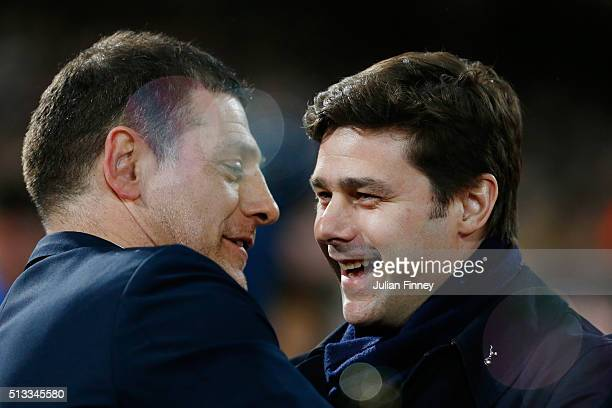 Slaven Bilic manager of West Ham United and Mauricio Pochettino Manager of Tottenham Hotspur prior to the Barclays Premier League match between West...