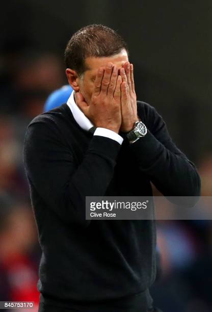 Slaven Bilic Manager of West Ham United reacts during the Premier League match between West Ham United and Huddersfield Town at London Stadium on...