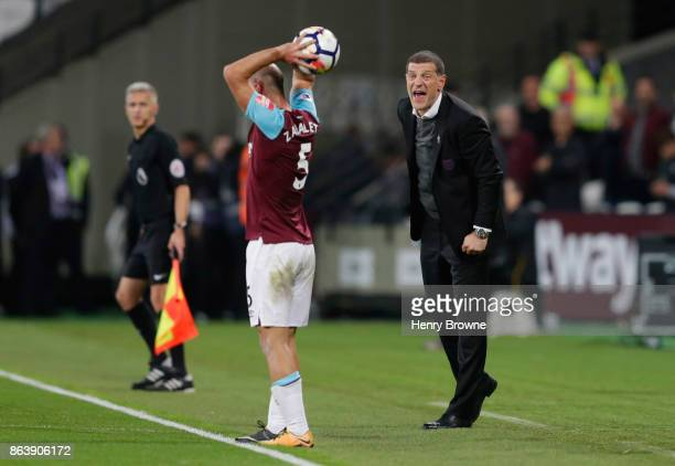 Slaven Bilic Manager of West Ham United shouts instructions as Pablo Zabaleta of West Ham United takes a throw in during the Premier League match...