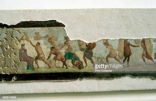 Slaves building a wall watched by a taskmaster Roman Fragment of a wall painting