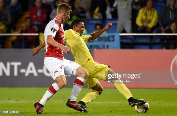 Slavia Prague's defender from Czech Republic Jakub Jugas vies with Villarreal's Colombian forward Carlos Bacca during the Europa League football...