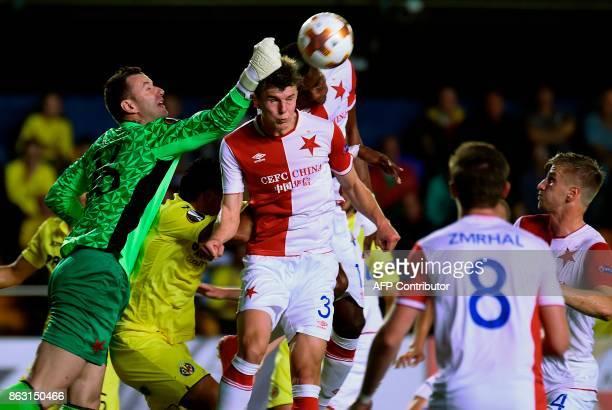 Slavia Prague's goalkeeper from Czech Republic Jan Lastuvka jumps for the ball during the Europa League football match Villarreal CF vs SK Slavia...