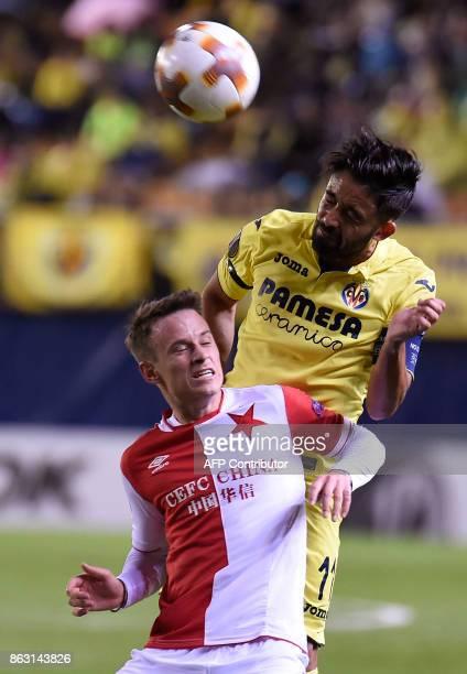 Slavia Prague's midfielder from Czech Republic Jan Sykora vies with Villarreal's defender Jaume Costa during the Europa League football match...