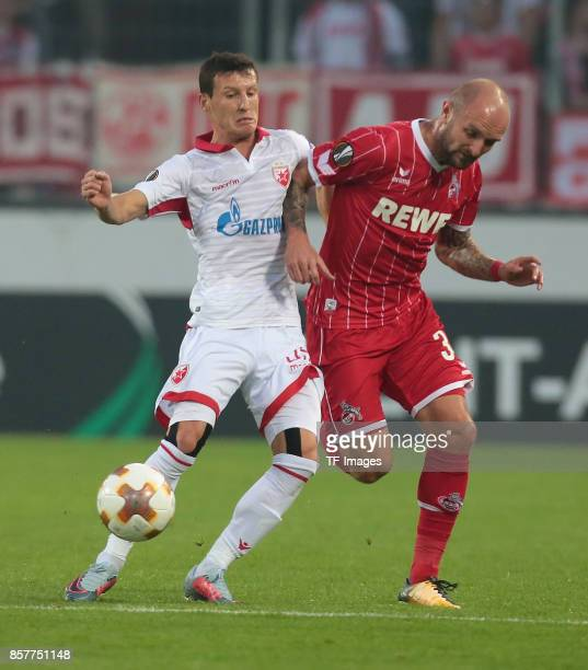 Slavoljub Srnic of Belgrad and Konstantin Rausch of Koeln battle for the ball during the UEFA Europa League group H match between 1 FC Koeln and...
