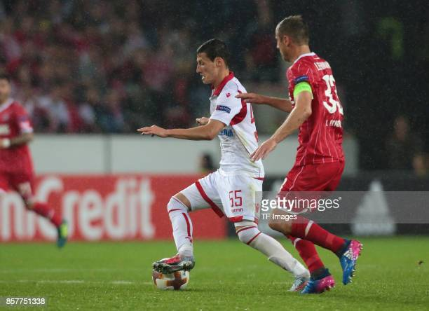 Slavoljub Srnic of Belgrad and Matthias Lehmann of Koeln battle for the ball during the UEFA Europa League group H match between 1 FC Koeln and...