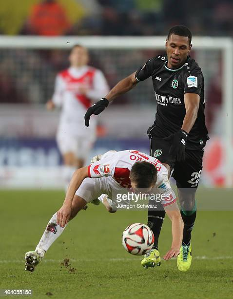 Slawomir Peszko of Cologne falls in front of Marcelo of Hannover during the Bundesliga match between 1 FC Koeln and Hannover 96 at...