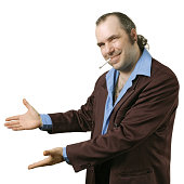 """""""A sleazy car salesman, Con man, retro suit wearing man with happy smile showing you his deals."""""""
