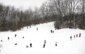 Sled riders enjoy a day at Slab Cabin Park in State College Pennsylvania Thursday December 27 2012