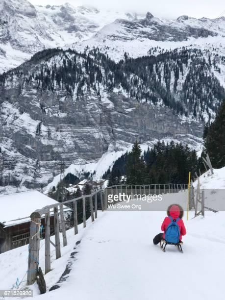 Sledding down from Mürren