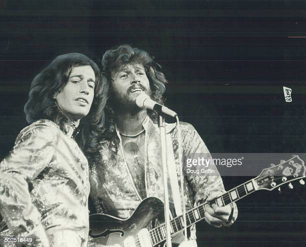 Sleek and silvery Robin and Barry Gibb of the Bee Gees performing at Maple Leaf Gardens last night in a show that was family funk True there was some...