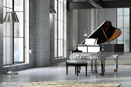 Sleek black grand piano in well lit room
