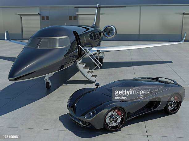 Sleek black sports car and black corporate jet