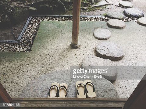 Sleepers On Stepping Stones In Japanese Garden
