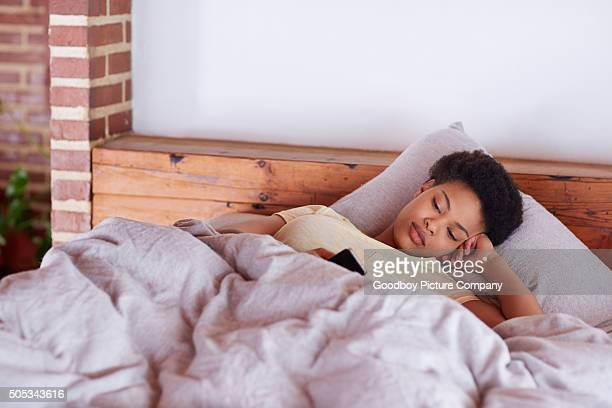 Sleepily going through her text messages