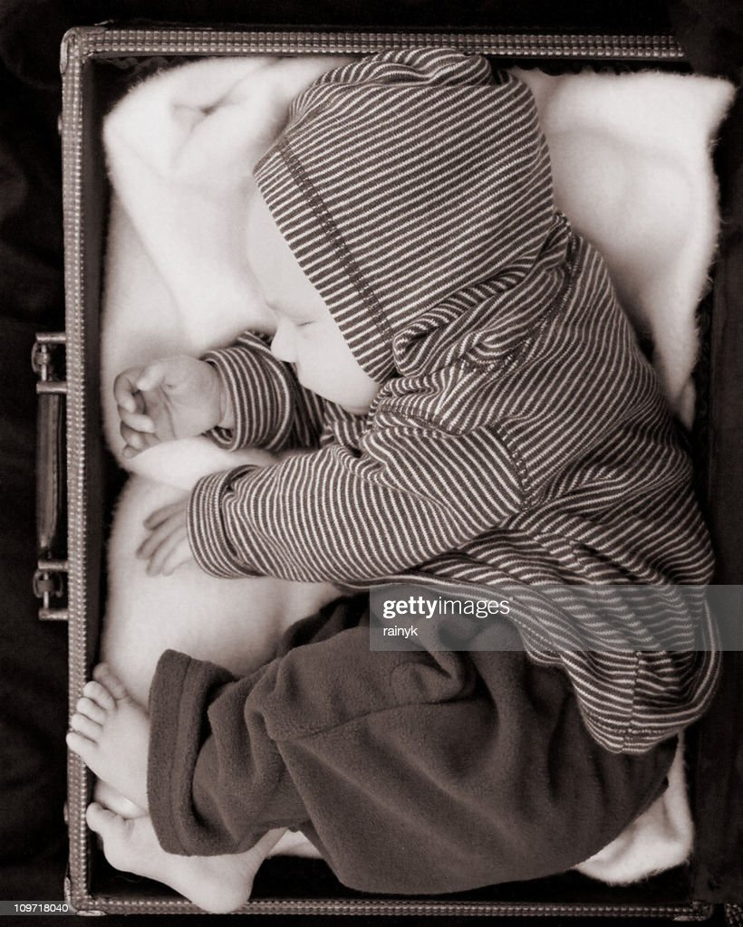 sleeping baby in suitcase : Stock Photo