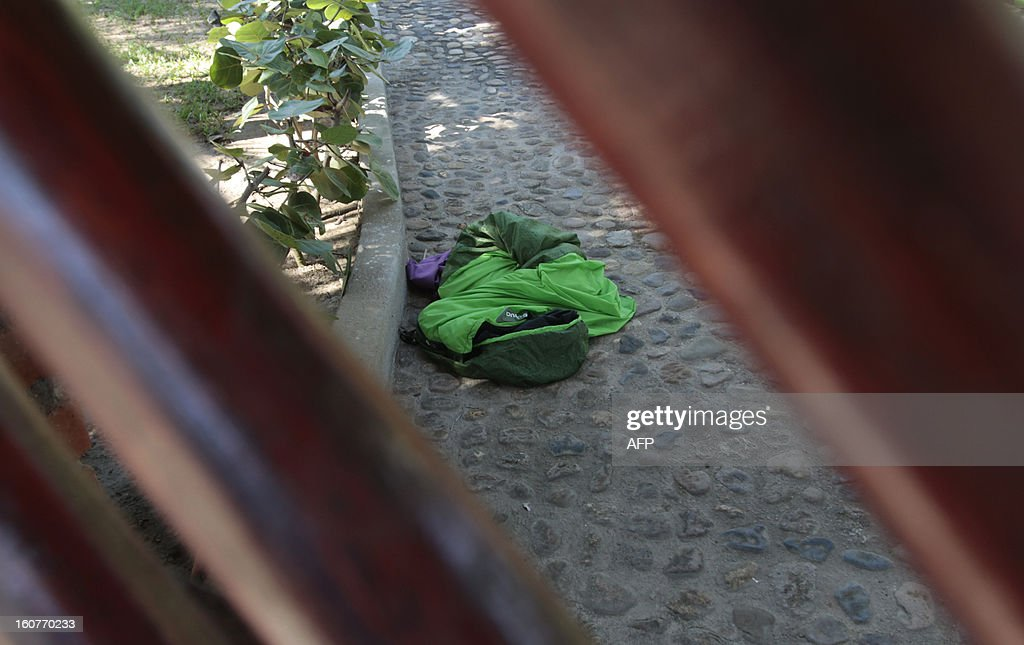 A sleeping bag is seen on the ground on February 5, 2013 at the entrance of the house where six Spanish women tourists were raped by masked gunmen early Monday, in Barra Vieja, a resort in Acapulco, in the Mexican state of Guerrero. Acapulco mayor Luis Walton Aburto said in a briefing that the group of tourists was attacked outside a house in Barra Vieja, and that hooded gunmen raped the six women who were with another seven Spaniards as well as a Mexican woman. AFP PHOTO/Pedro Pardo