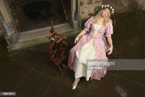 Sleeping Beauty played by actress Elisabeth Knoche reclines in her 100year sleep after she pricked her finger on a spindle at Sababurg Palace on...