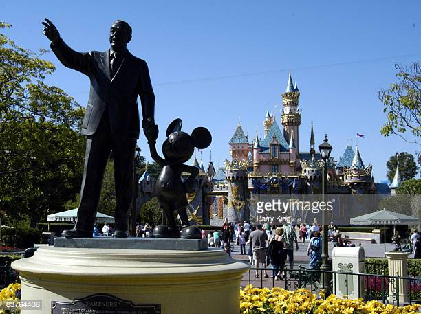 Sleeping Beauty's Castle and statue of Walt Disney and Mickey Mouse