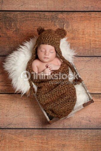 Sleeping Newborn Baby Boy Wearing a Bear Hat   Stock Photo 57d236fe3389