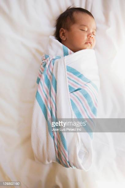 Sleeping newborn mixed race baby girl