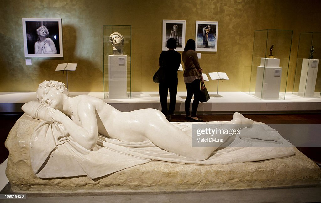 Sleeping Nymph (1822) by Antonio Canova is displayed during a press preview of the 'Marilyn' exhibition at Prague Castle on May 29, 2013 in Prague, Czech Republic. The exhibition was created by the Museo Salvatore Ferragamo in Florence, in 2012. Marilyn Monroe loved and owned many pairs of shoes made by Ferragamo. The Marilyn exhibition, which commemorates the 50th anniversary of her death, runs at the Riding School until September 20, 2013. The exhibition will present 30 pairs of shoes and over 50 outfits and other accessories from Marylin's personal, public and movie wardrobe and also historical movie clips, magazine covers and Marilyn's original writings.