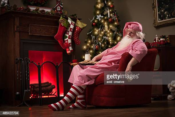 Sleeping Santa in Sofa Chair with Milk and Cookies