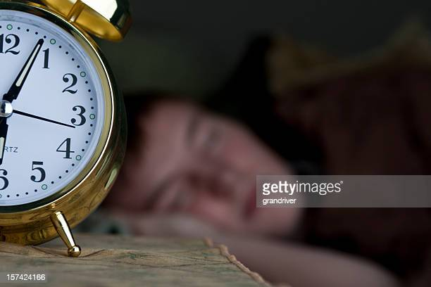 Sleeping Teenage Boy with Alarm Clock