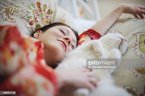 Sleeping woman in kimono with cat