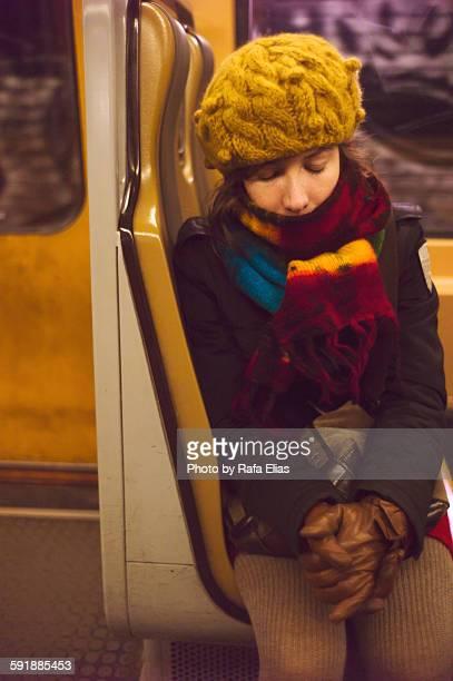 Sleeping woman sitting in a train wagon
