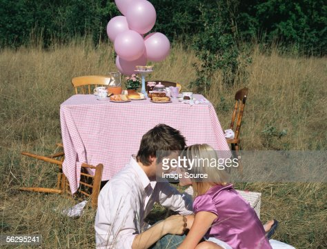 Sleepy couple at a picnic : Stock Photo