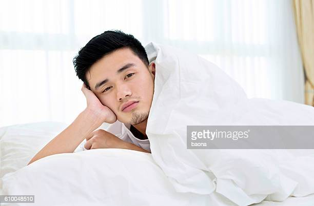 Sleepy man in bed