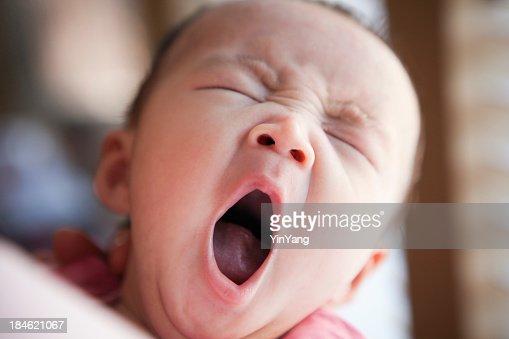 Sleepy Three Months Old Asian Baby Yawning