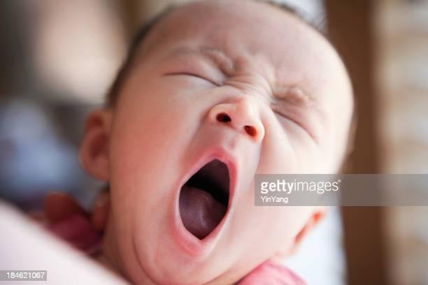 Sleepy Three Months Old Asian Baby Yawning