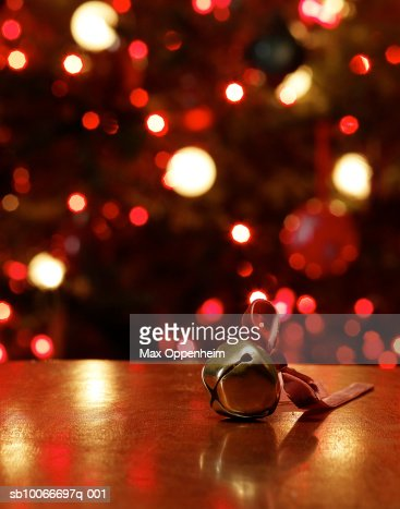 Sleigh bell  on table in front of Christmas tree : Stock Photo