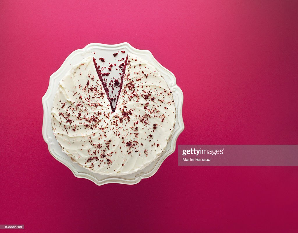 Slice missing from chocolate cake on cakestand : Stock Photo