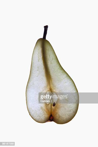 A slice of an organic pear on a lightbox