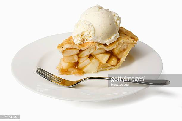 Slice of apple pie a la mode on a plate with a fork