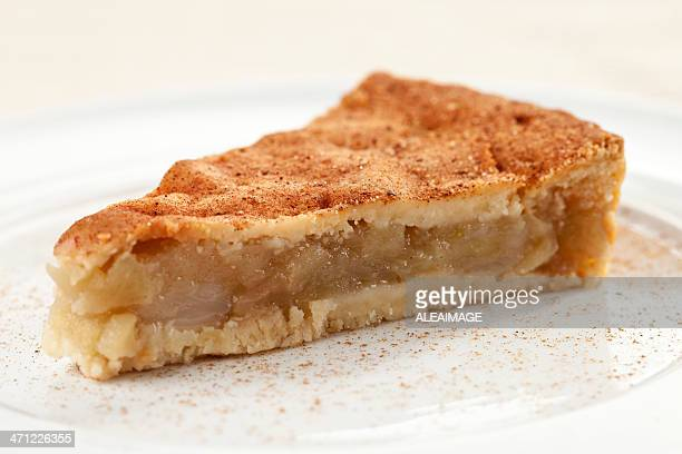A slice of apple pie with cinnamon