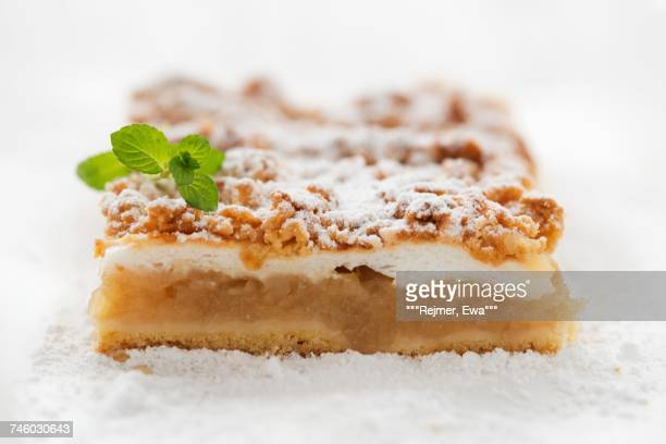 A slice of apple pie with crumble topping
