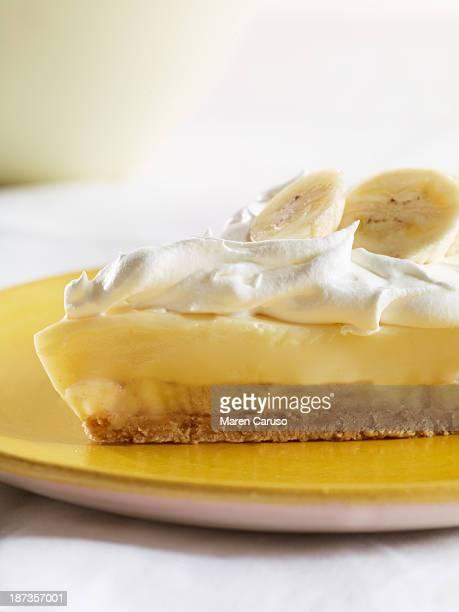 Slice of Banana Cream Pie on Yellow Plate