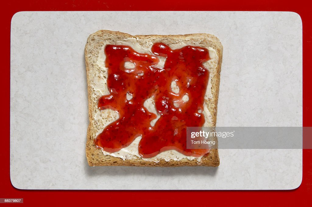 Slice of bread with jelly, close-up : Stock Photo