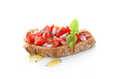 Delicious bruschetta with chopped tomatoes, onion and fresh herbs and olive oil. Culinary mediterranean eating.