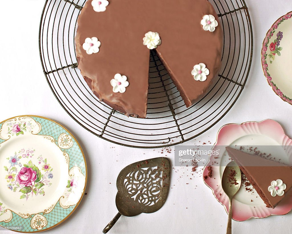 Slice of cake on plate with vintage spoon : Stock Photo