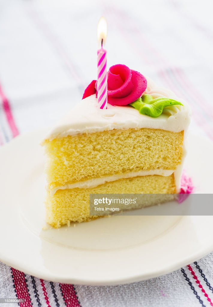 Slice of cake with candle : Stock Photo