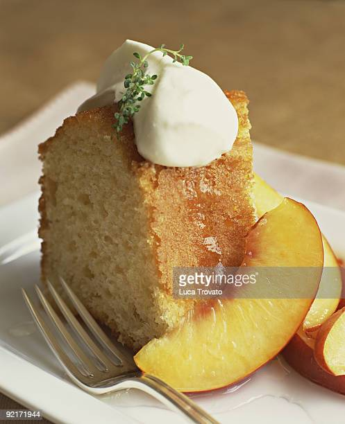 Slice of cake with fresh peaches