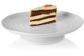 Slice of carrott cake sat on a porcelain cake stan