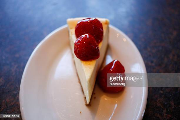 A slice of cheesecake is arranged for a photograph at a Cheesecake Factory Inc restaurant in Louisville Kentucky US on Wednesday Nov 13 2013 Last...