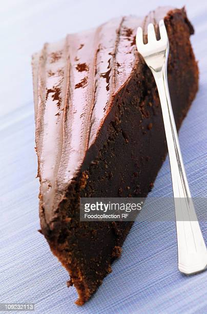 USA, Slice of chocolate cake with fork, close-up